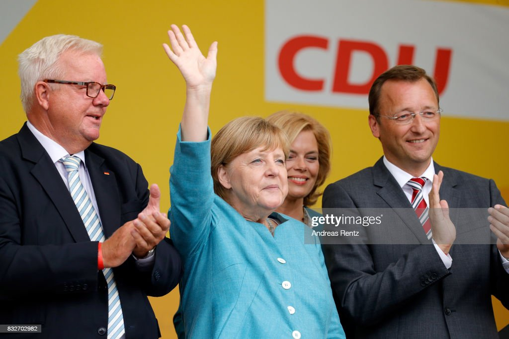 Michael Fuchs, German Chancellor and head of the German Christian Democrats (CDU) Angela Merkel, Chairman of CDU Rheinland-Pfalz Julia Kloeckner and Josef Oster, candidate for the German parliament, greet supporters after an election rally at the headland known as the 'Deutsches Eck' ('German Corner'), where the Mosel and Rhine rivers meet, on August 16, 2017 in Koblenz, Germany. Germany is scheduled to hold federal elections on September 24 and Merkel, who is running for a fourth term as chancellor, currently holds a double-digit lead over Martin Schulz from the German Social Democrats (SPD), her main opponent.