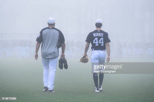 Michael Fulmer and Daniel Norris of the Detroit Tigers walk across the field together in the fog during Spring Training workouts at the TigerTown...