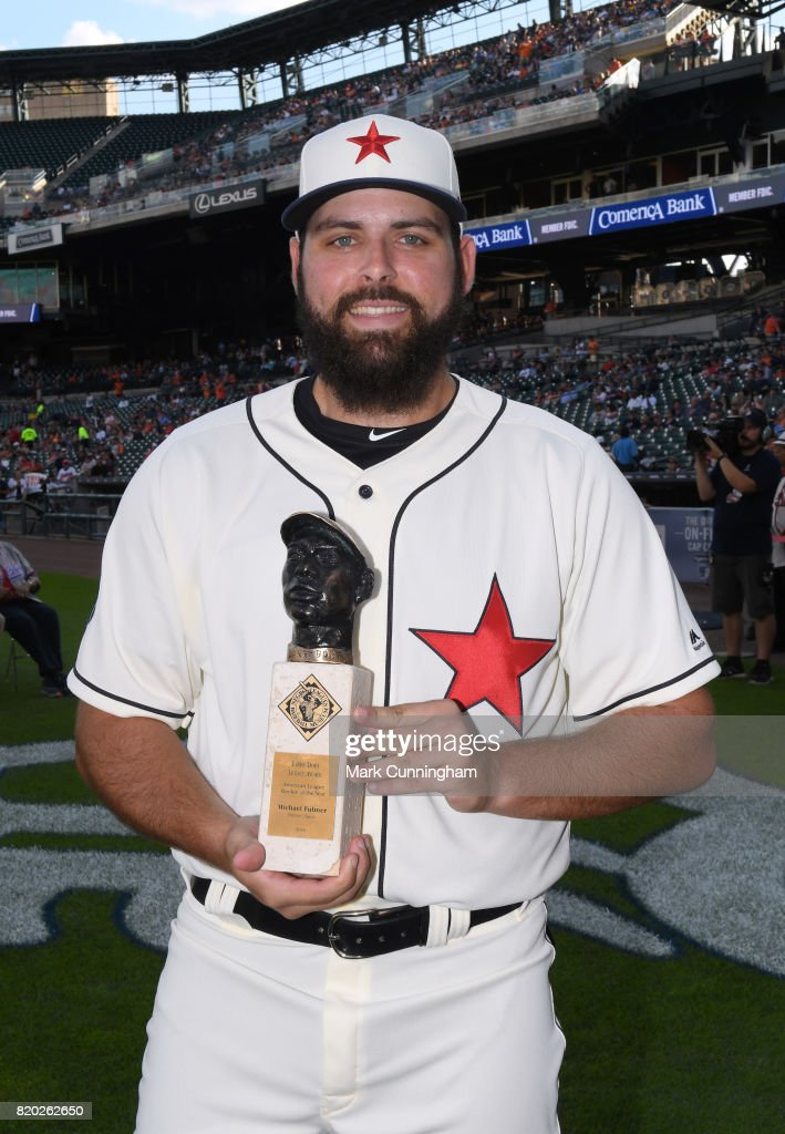 Michael Fulmer #32 of the Detroit Tigers poses for a photo with his Larry Doby Legacy Award for American League Rookie of the Year while wearing a Detroit Stars Negro League Tribute uniform prior to game two of a double header against the Cleveland Indians at Comerica Park on July 1, 2017 in Detroit, Michigan. The Indians defeated the Tigers 4-1.