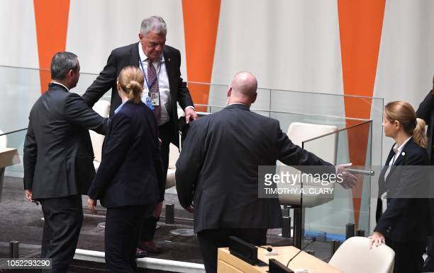 Michael G Kozak Senior Official Bureau of Democracy Human Rights and Labor of the United States is shown out of the room by UN Security after members...