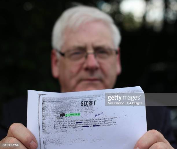 Michael Gallagher who lost his son Aidan in the Omagh bomb attack holds a redacted email from a Real IRA mole during a press conference on behalf of...