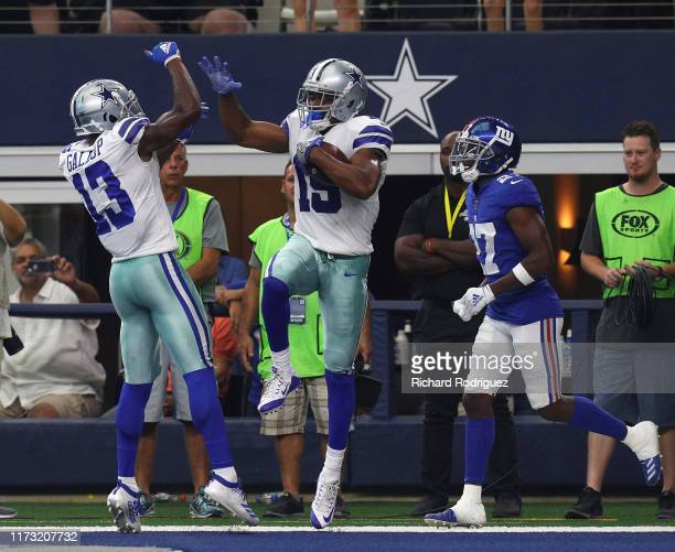 Michael Gallup and Amari Cooper of the Dallas Cowboys celebrate a secodn quarter touchdown against the New York Giants at ATT Stadium on September 08...