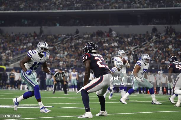 Michael Gallup of the Dallas Cowboys and Johnson Bademosi of the Houston Texans during a NFL preseason game at ATT Stadium on August 24 2019 in...