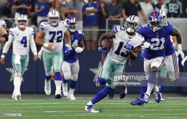 Michael Gallup of the Dallas Cowboys carries the ball as he is pursued by Jabrill Peppers of the New York Giants in the fourth quarter at ATT Stadium...