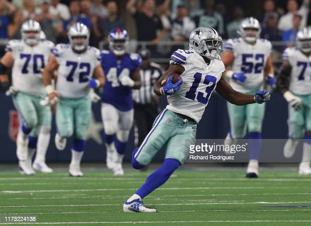 Michael Gallup of the Dallas Cowboys carries the ball in the third quarter against the New York Giants at ATT Stadium on September 08 2019 in...