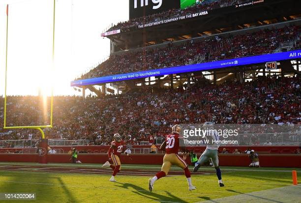 Michael Gallup of the Dallas Cowboys catches a touchdown pass over Jimmie Ward of the San Francisco 49ers in the first quarter of their NFL preseason...
