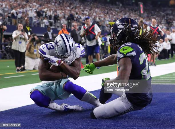 Michael Gallup of the Dallas Cowboys comes down with the touchdown reception against Shaquill Griffin of the Seattle Seahawks in the second quarter...