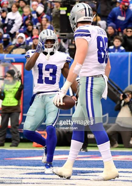 Michael Gallup of the Dallas Cowboys congratulates Blake Jarwin on his touchdown against the New York Giants at MetLife Stadium on December 30 2018...