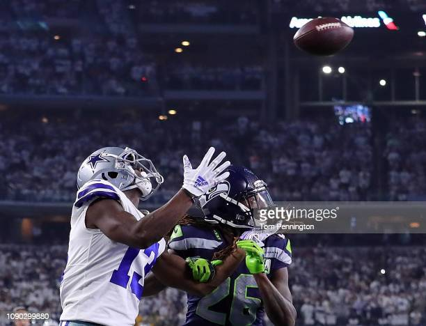 Michael Gallup of the Dallas Cowboys goes to make a touchdown reception against Shaquill Griffin of the Seattle Seahawks in the second quarter during...