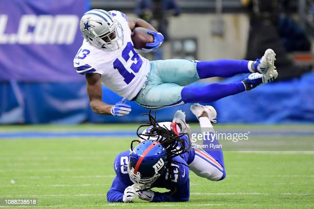 Michael Gallup of the Dallas Cowboys is tripped up after a first down catch by Janoris Jenkins of the New York Giants during the fourth quarter at...