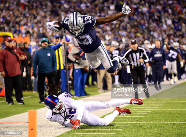 Michael Gallup of the Dallas Cowboys jumps over Janoris Jenkins of the New York Giants for a touchdown in the fourth quarter of their game at MetLife...