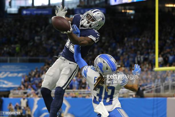 Michael Gallup of the Dallas Cowboys makes a catch in the second quarter of the game against the Mike Ford of the Detroit Lions at Ford Field on...