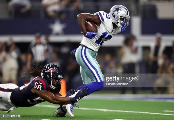Michael Gallup of the Dallas Cowboys runs the ball against Peter Kalambayi of the Houston Texans in the first quarter during a NFL preseason game at...