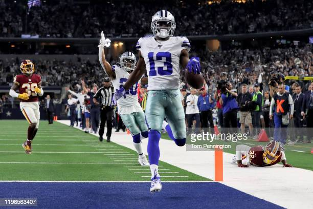 Michael Gallup of the Dallas Cowboys scores a touchdown in the third quarter against the Washington Redskins in the game at ATT Stadium on December...