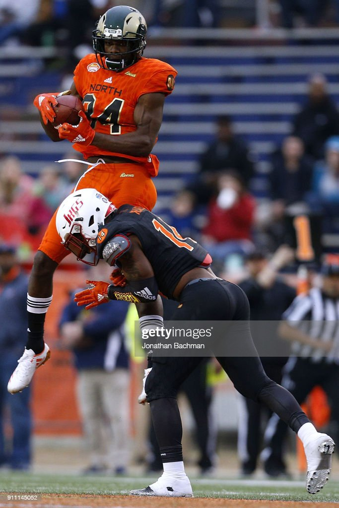 Michael Gallup #84 of the North team catches the ball as Jeremy Reaves #14 of the South team defends during the second half of the Reese's Senior Bowl at Ladd-Peebles Stadium on January 27, 2018 in Mobile, Alabama.