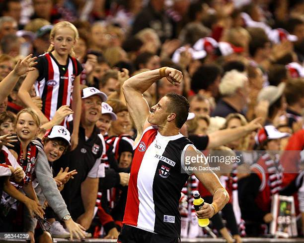 Michael Gardiner of the Saints celebrates with fans after his teams win in the round three AFL match between the St Kilda Saints and the Collingwood...