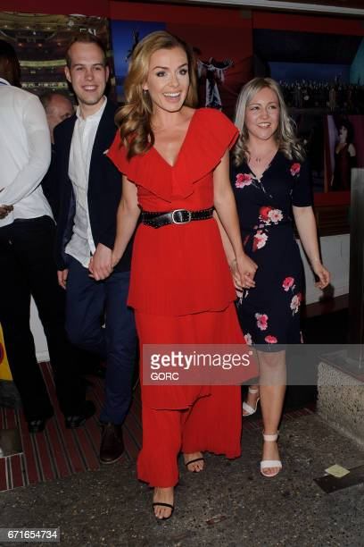 Michael Gardner and fiancee Amy Eley pose for pictures outside the Coliseum theatre with Katherine Jenkins after getting engaged on stage during a...
