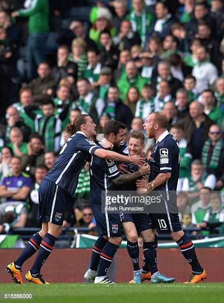 Michael Gardyne of Ross County celebrates scores a goal in the first half with his teammates during the Scottish League Cup Final between Hibernian...