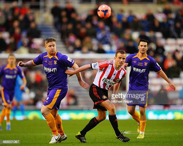 Michael Gash of Kidderminster competes for the ball with Lee Cattermole of Sunderland during the FA Cup Fourth Round match between Sunderland and...