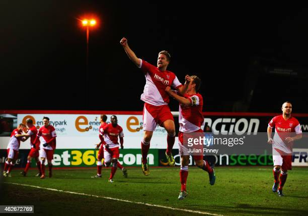 Michael Gash of Kidderminster Harriers celebrates with team mates as he scores their first goal during the FA Cup with Budweiser Third round replay...