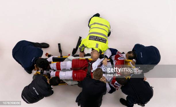 Michael Gaspar of the Czech Republic is tended to by paramedics after getting hurt in Group A hockey action of the 2019 IIHF World Junior...