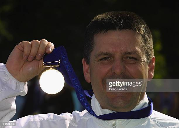Michael Gault of England celebrates winning gold in the Men's 50m Air Pistol Singles Final during the 2002 Commonwealth Games in Bisley England on...