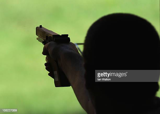 Michael Gault of England fires his gun during the 25m Standard Pistol Mens Pairs final on the day ten of the Delhi 2010 Commonwealth Games on October...