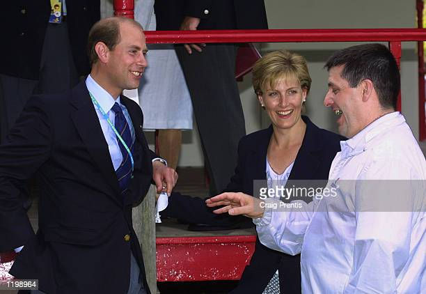 Michael Gault of England shares a joke with the Earl and Countess of Wessex before collecting gold in the Men's 50m Air Pistol Singles Final during...