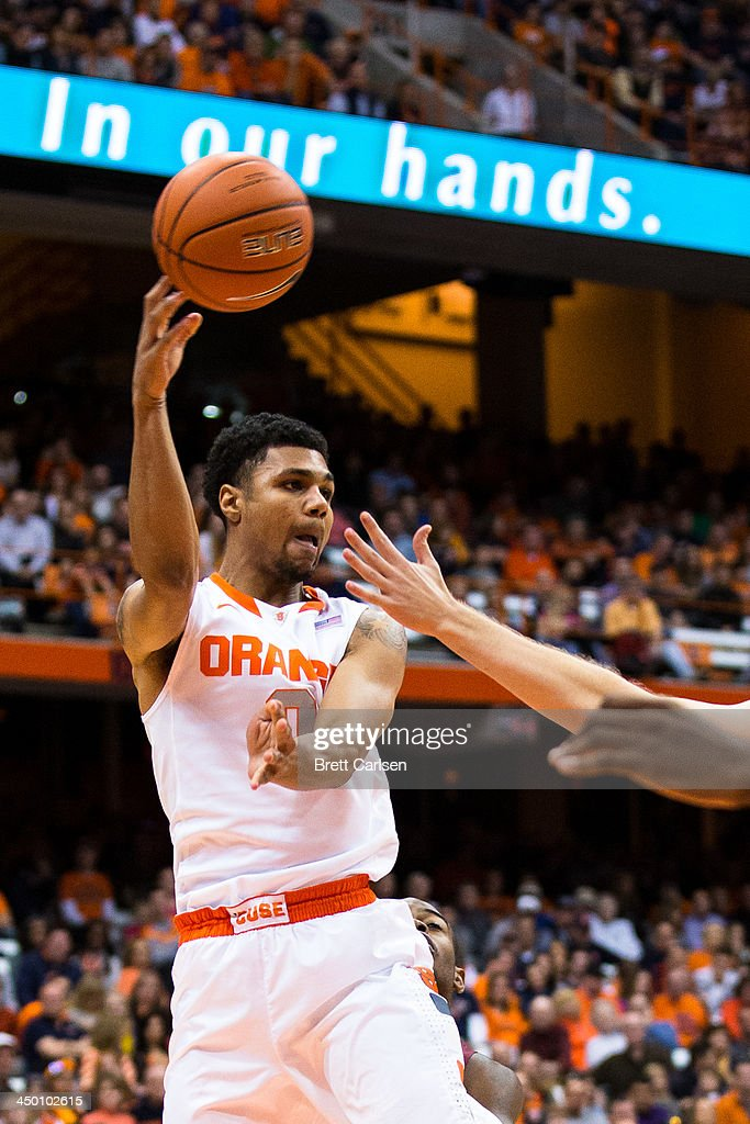 Michael Gbinije #0 of Syracuse Orange passes the ball out of the key during a basketball game against Colgate Raiders on November 16, 2013 at the Carrier Dome in Syracuse, New York. Syracuse defeated Colgate 69-50.