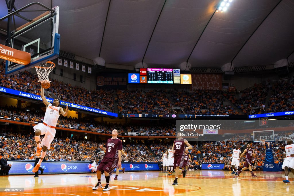 Michael Gbinije #0 of Syracuse Orange puts in a breakaway layup after the ball was stolen from the Colgate Raiders during the second half of a basketball game on November 16, 2013 at the Carrier Dome in Syracuse, New York. Syracuse defeated Colgate 69-50.