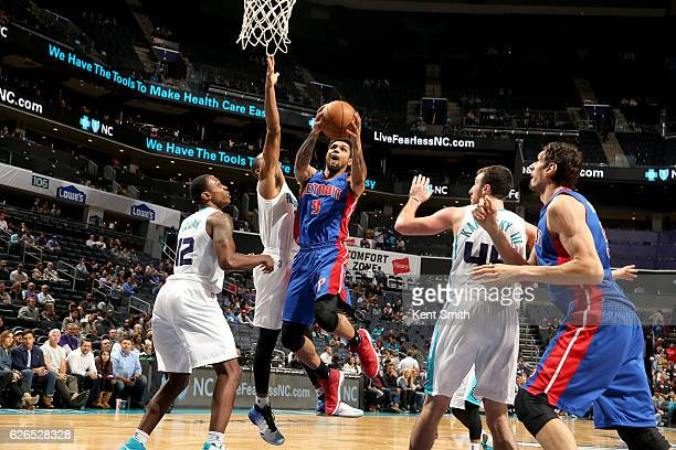 Michael Gbinije of the Detroit Pistons goes to the basket against the Utah Jazz on November 29 2016 at Spectrum Center in Charlotte North Carolina...