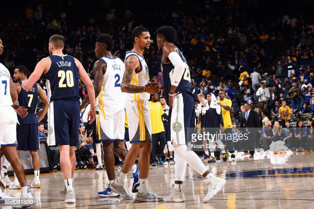 Michael Gbinije of the Golden State Warriors shakes hands with Malik Beasley of the Denver Nuggets after the game during a preseason game on...