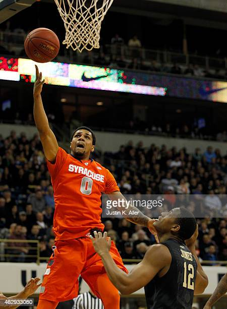 Michael Gbinije of the Syracuse Orange attempts a layup against Chris Jones of the Pittsburgh Panthers during the game at Petersen Events Center on...