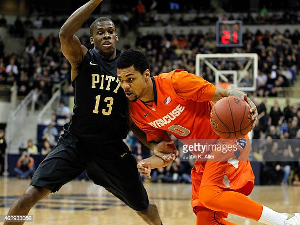 Michael Gbinije of the Syracuse Orange drives to the basket against Josh Newkirk of the Pittsburgh Panthers during the game at Petersen Events Center...