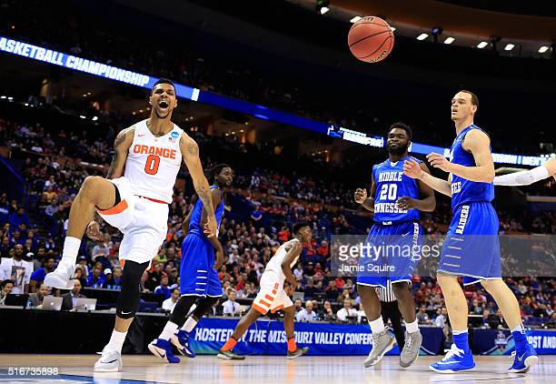 Michael Gbinije of the Syracuse Orange dunks in the first half as Giddy Potts and Reggie Upshaw of the Middle Tennessee Blue Raiders look on during...