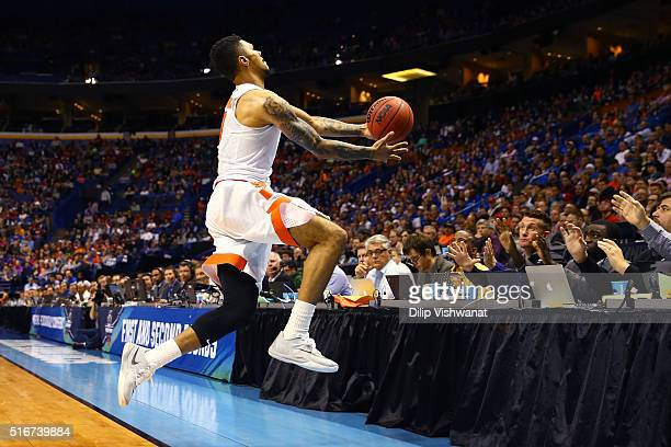 Michael Gbinije of the Syracuse Orange jumps out of bounds trying to save the ball in the second half against the Middle Tennessee Blue Raiders...