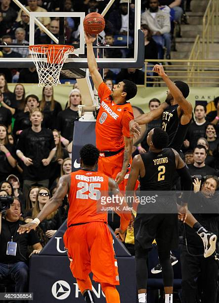Michael Gbinije of the Syracuse Orange lays one in against the Pittsburgh Panthers during the game at Petersen Events Center on February 7 2015 in...