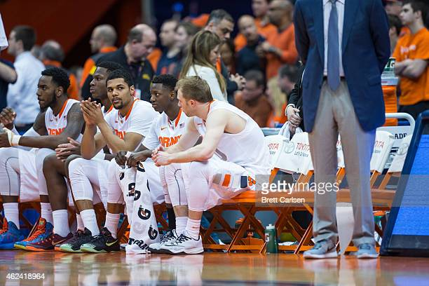 Michael Gbinije of the Syracuse Orange sits on the bench with teammates Rakeem Christmas Tyler Roberson Kaleb Joseph and Trevor Cooney before the...
