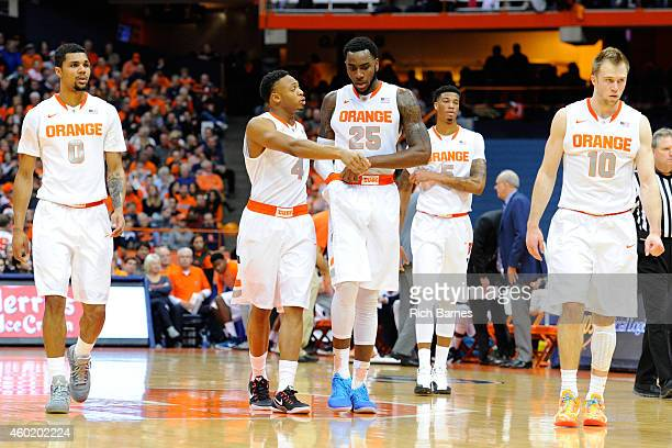 Michael Gbinije Ron Patterson Rakeem Christmas Chris McCullough and Trevor Cooney of the Syracuse Orange walk on the court following a timeout in the...