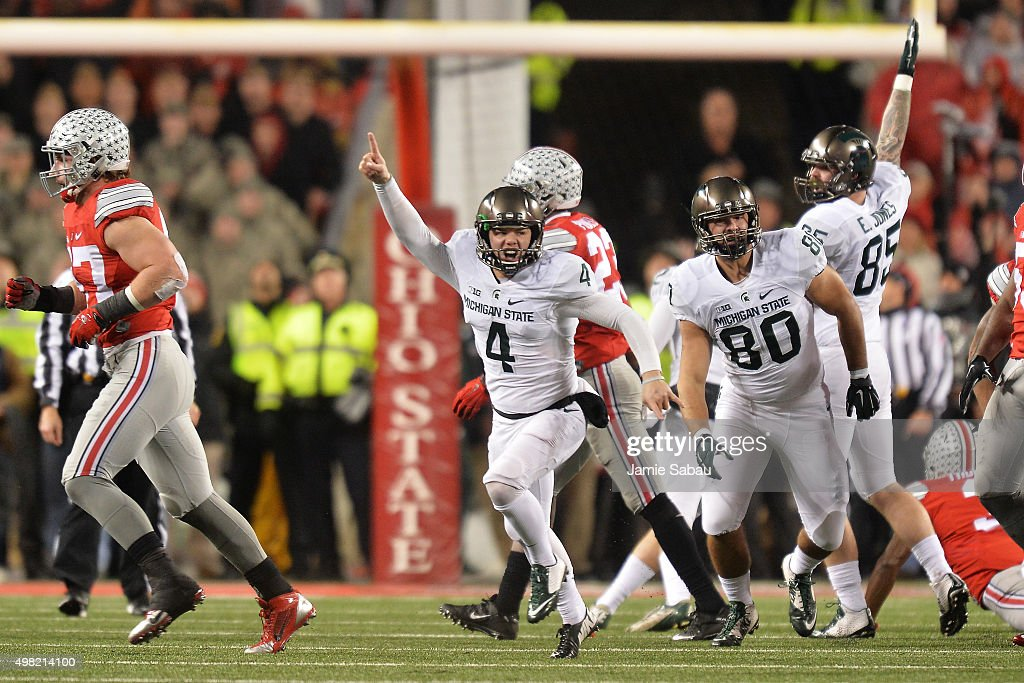 Michael Geiger #4 of the Michigan State Spartans celebrates after kicking a 41-yard field goal as time expired against the Ohio State Buckeyes at Ohio Stadium on November 21, 2015 in Columbus, Ohio. Michigan State defeated Ohio State 17-14.