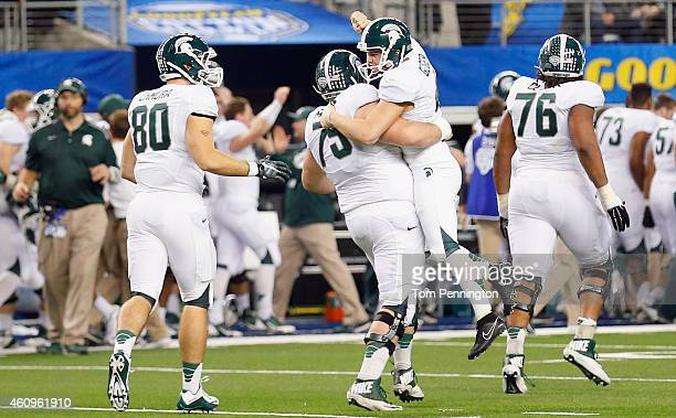 Michael Geiger of the Michigan State Spartans celebrates with Benny McGowan of the Michigan State Spartans after kicking the game winning extra point...