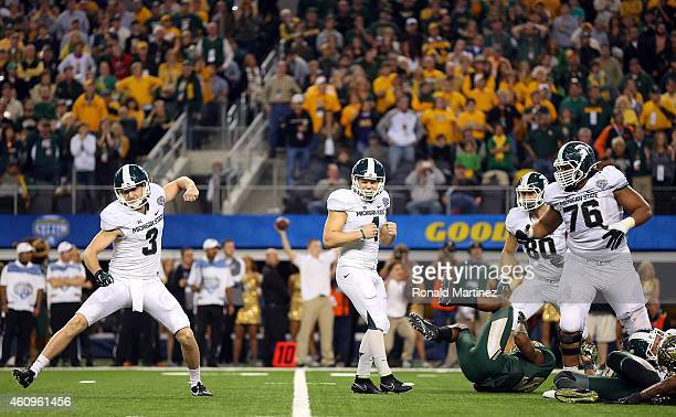 Michael Geiger of the Michigan State Spartans Mike Sadler of the Michigan State Spartans and Donavon Clark of the Michigan State Spartans celebrate...