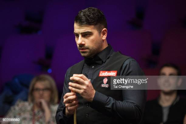 Michael Georgiou of Cyprus chalks the cue during his second round match against Stephen Maguire of Scotland on day three of 2018 Ladbrokes World...