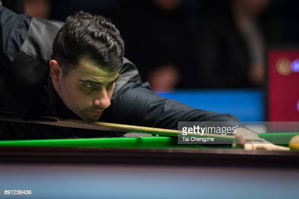 Michael Georgiou of Cyprus plays a shot during his first round match against Ronnie O'Sullivan of England on day two of the 2017 Scottish Open at...