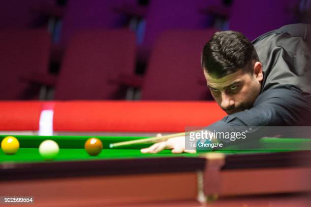 Michael Georgiou of Cyprus plays a shot during his second round match against Stephen Maguire of Scotland on day three of 2018 Ladbrokes World Grand...