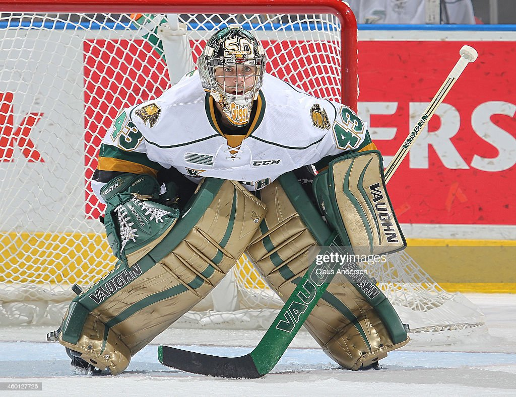 Michael Giugovaz #43 of the London Knights keeps a watch for an incoming shot against the Sault Ste. Marie Greyhounds in an OHL game at Budweiser Gardens on December 5, 2014 in London, Ontario, Canada. The Greyhounds defeated the Knights 4-0.