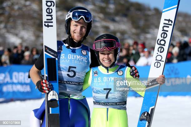 Michael Glasder and Sarah Hendrickson pose for photographers after the US Men's and Womens Ski Jumping Olympic Trials on December 31 2017 at Utah...