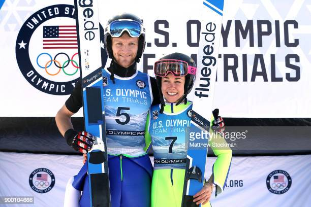 Michael Glasder and Sarah Hendrickson pose on the medals podium after the US Men's and Womens Ski Jumping Olympic Trials on December 31 2017 at Utah...