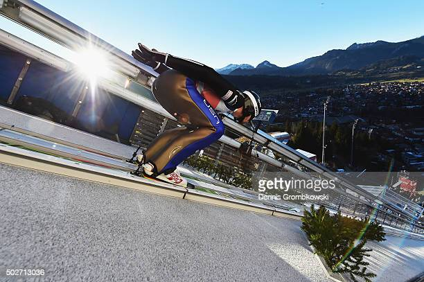 Michael Glasder of the United States accelerates down the jumping hill during his training jump on Day 1 of the 64th Four Hills Tournament ski...