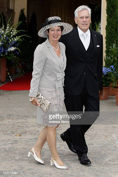 Michael Glos and wife Ilse Glos attend the religious wedding ceremony of Georg Friedrich Ferdinand Prince of Prussia to Princess Sophie of Prussia in...